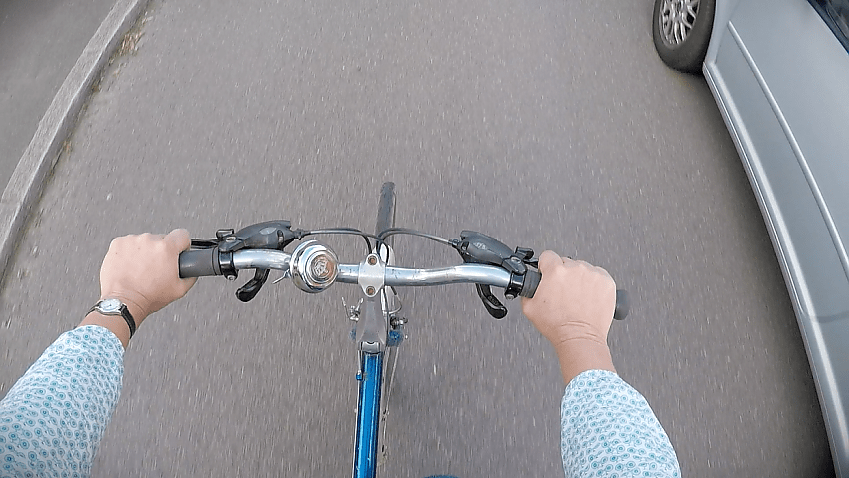 A driver passes a cyclist closely