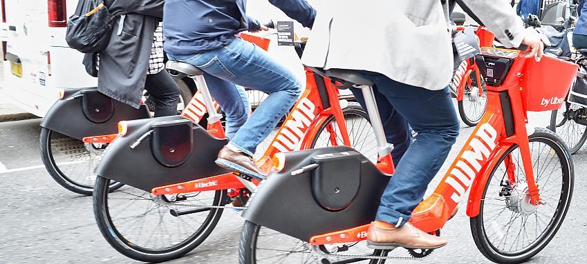 People riding e-bikes