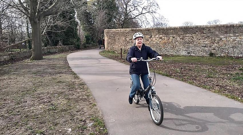 Mary gliding on a bike with pedals removed