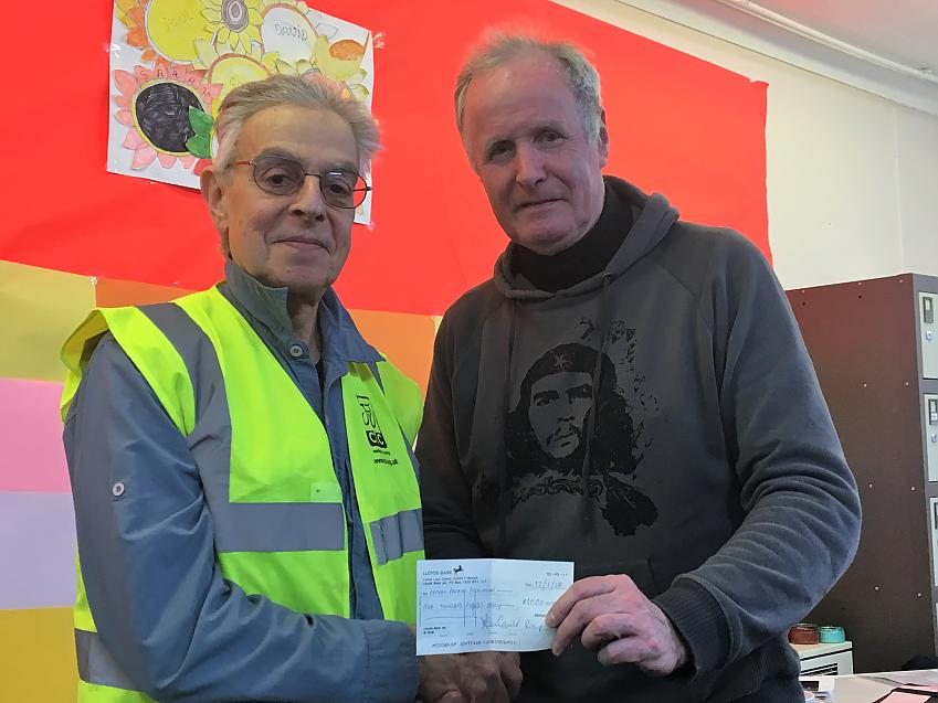 Derek Gould presents a cheque to Eastham Centre volunteer Paul Green