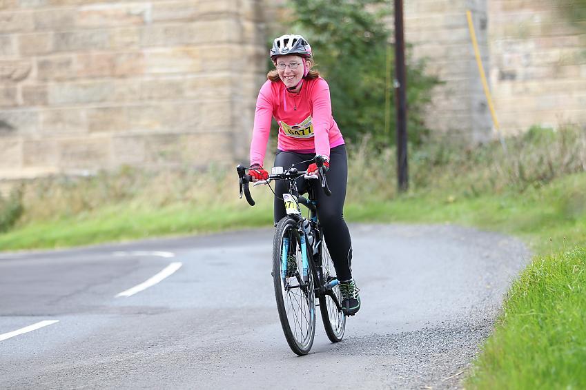 women on road bike