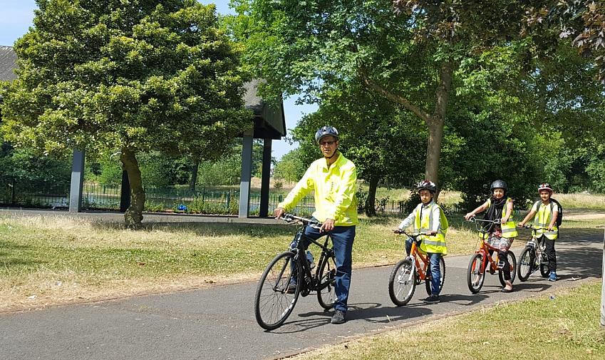 Nasaar leading children on a ride