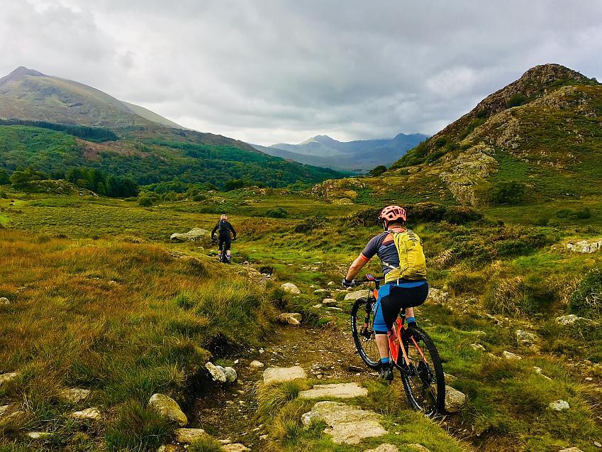 Two mountain bikers in Welsh mountain landscape