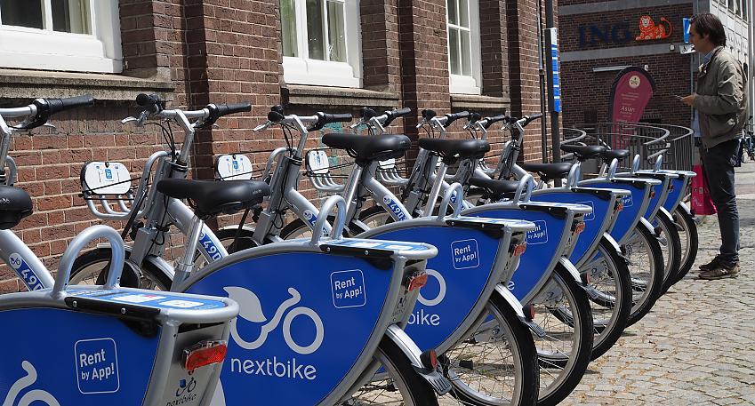 Row of nextbikes on a street