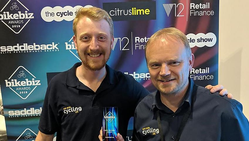 Cycling UK's Duncan Dollimore and Keir Gallagher receive the award
