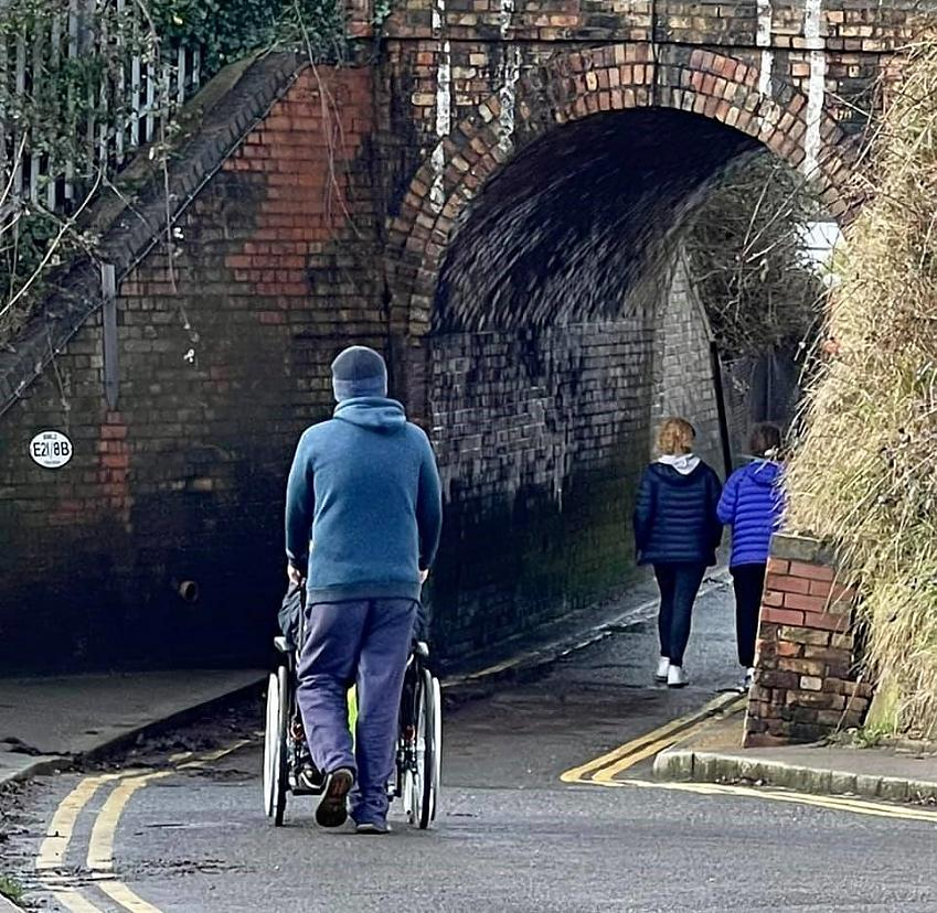 A wheelchair user passing under the Keyhole Bridge