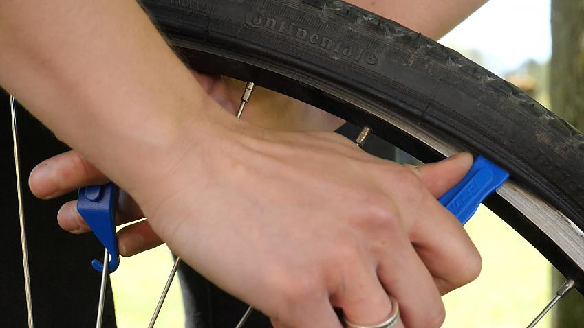 Use a pair of levers to remove the tyre