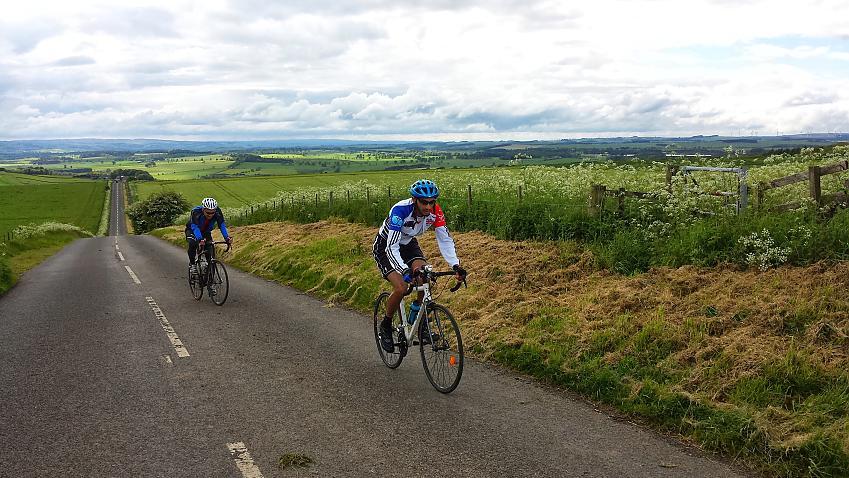 Riders on a climb