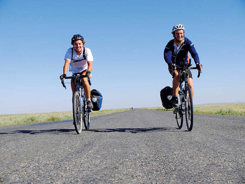 Will (left) and Charles ride through Kazakhstan