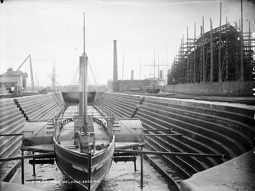Black and white photo of a ship in a graving dock in Belfast
