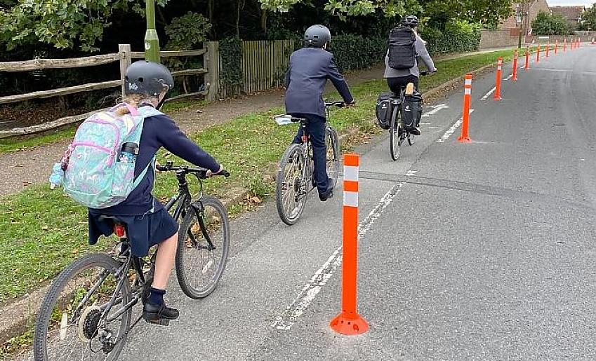 Children cycling to school along a temporary cycle lane