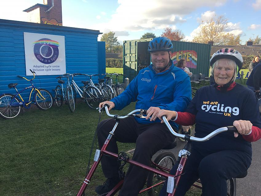 Sylvia giving Cycling Development Officer, Chris Alston, a tour of the circuit at Live! Project's  'Give it a Spin' Inclusive Cycling Session