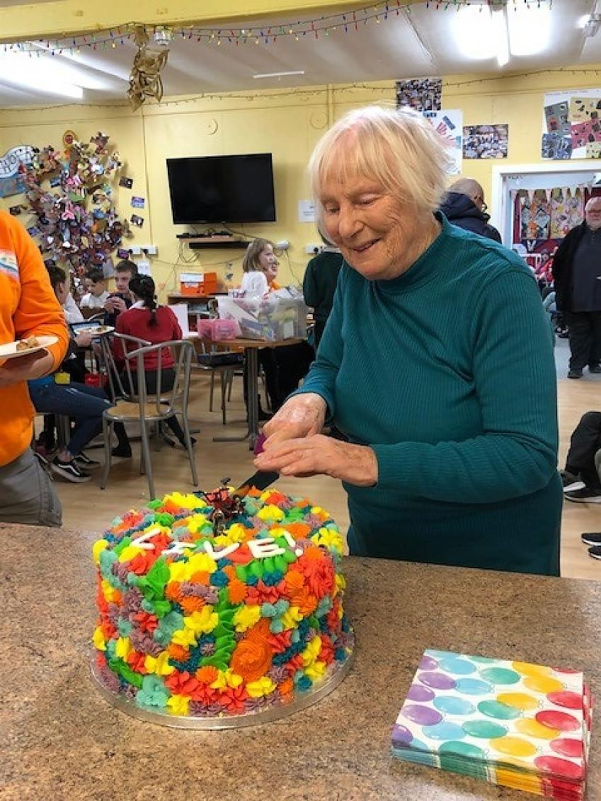Sylvia cutting into her birthday cake