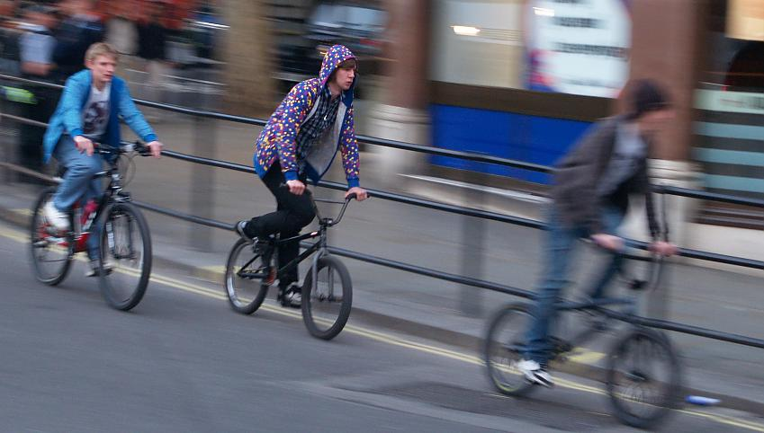 Teenage boys cycling in a city