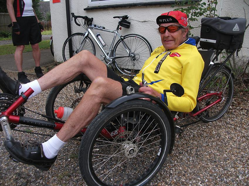 John Davis on his recumbent with his Tri-Vets date bars. Photo by Brian Penny