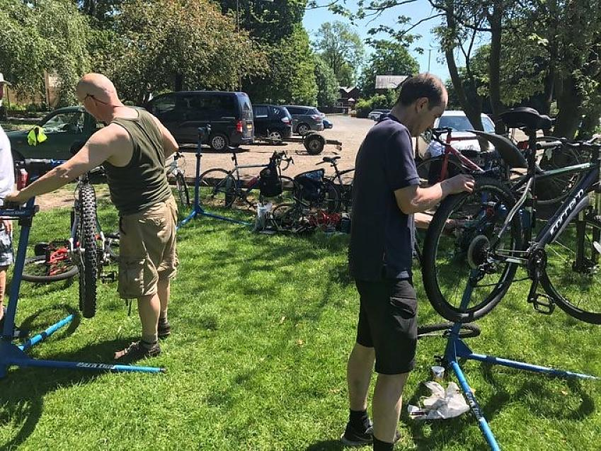Fixing bikes in the sunshine at a Bike Big Revival event