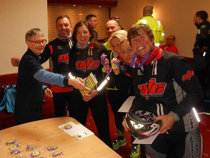 Early Season Challenge riders celebrate with certificates and medals