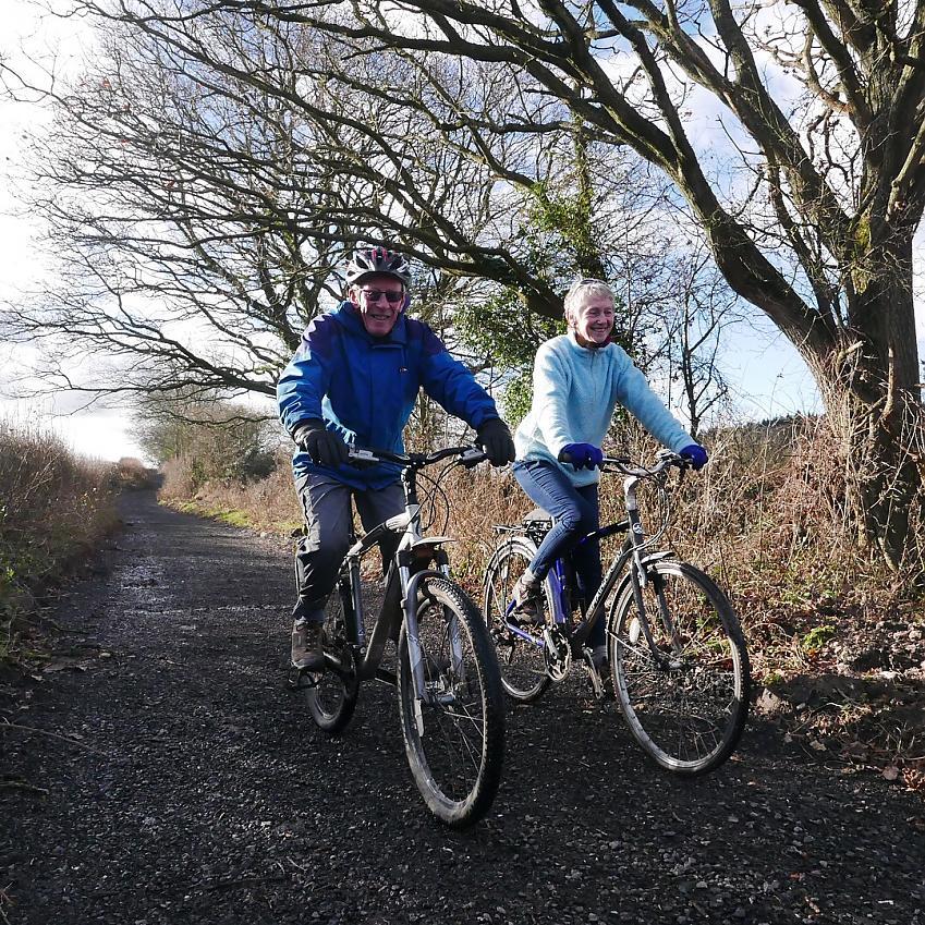 Dilys and Jeremy Gartside enjoying a ride on Little Lane