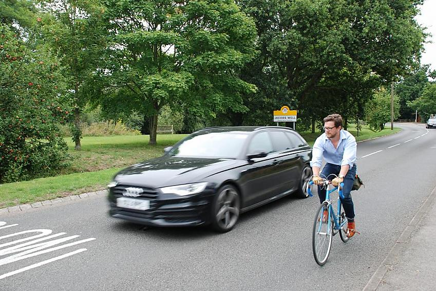 Cyclist being overtaken by car at speed