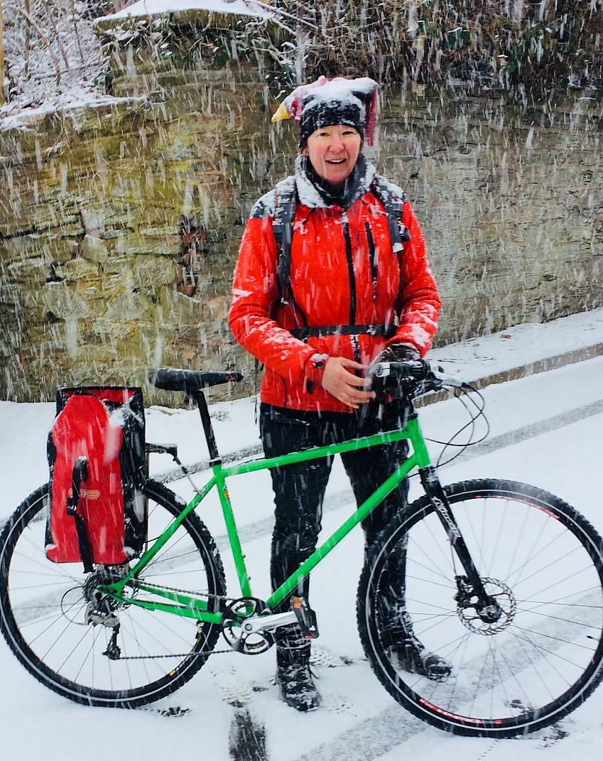 Liz Colebrook cycling in the snow
