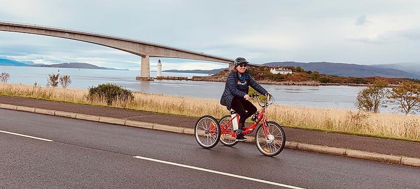 Shelagh on her trike in Skye