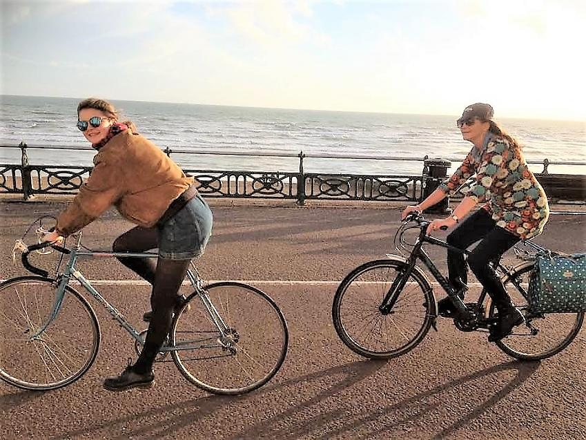 Julie and her daughter cycling together in Brighton