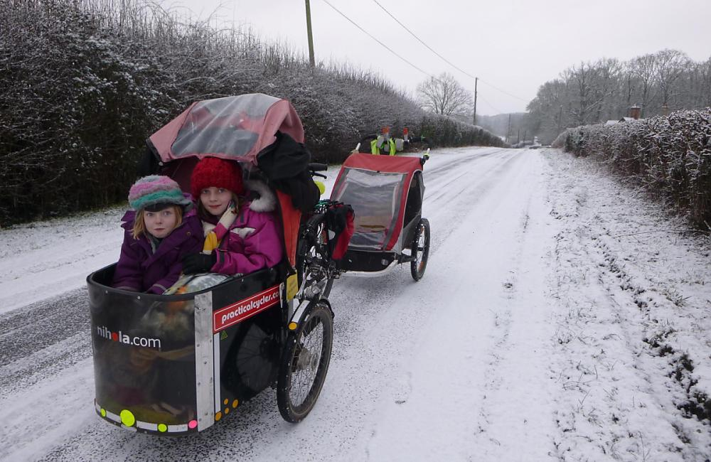 Josie Dew cycling to school in the snow