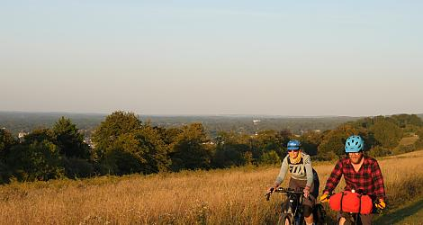 Two cyclists bikepacking in the Surrey Hills